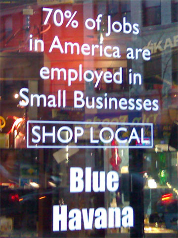 door sign reading, 70% of Jobs in America are employed in Small Businesses.  Shop Local.  Blue Havana.