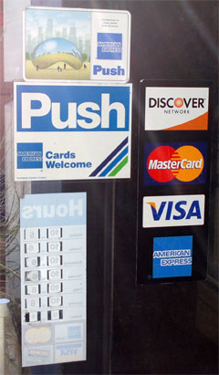 photo of credit card logos on retail store in Chicago