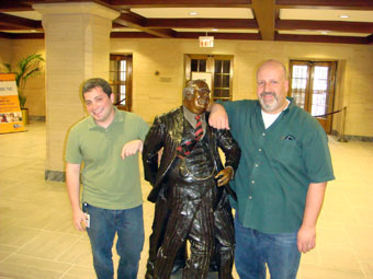 photo of Daniel Honigman, Bureaucratic Shuffle statue and Mike Maddaloni