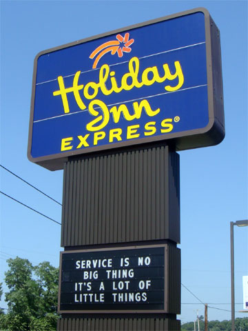 photo of Holiday Inn Express sign reading, Service is no Big Thing, It's a lot of Little Things