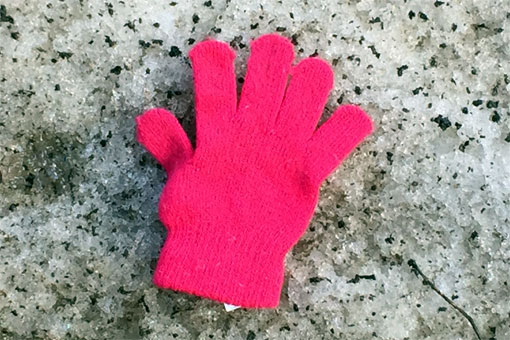 photo of kid's glove in the snow