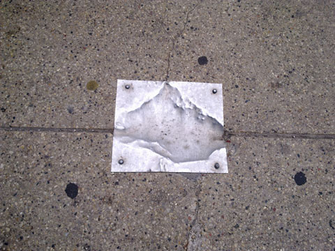 photo of metal sidewalk patch in Chicago