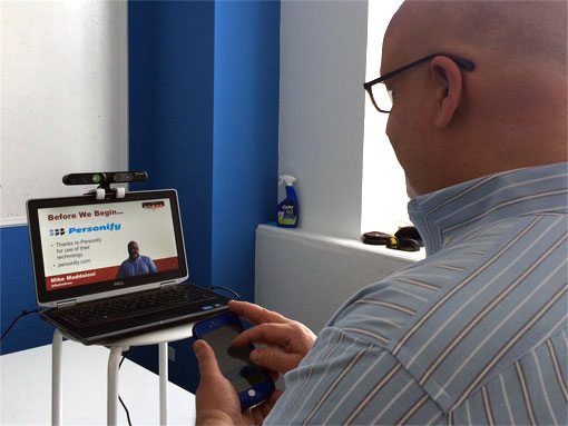 photo of remote presentation using Personify Plus with 3D camera and mobile app