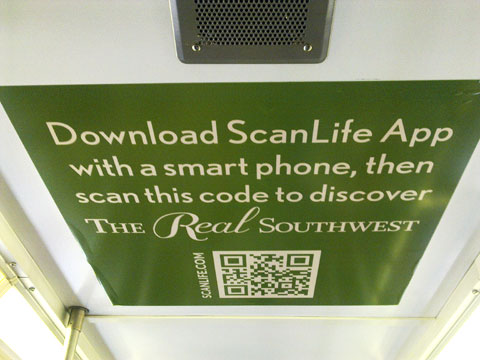 photo of QR codes for Real Southwest campaign on train ceiling