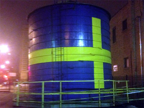 photo of gravity tank with Swedish flag painted on it in Andersonville, Chicago