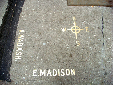 photo of compass in sidewalk at corner of Wabash and Madison, Chicago before construction