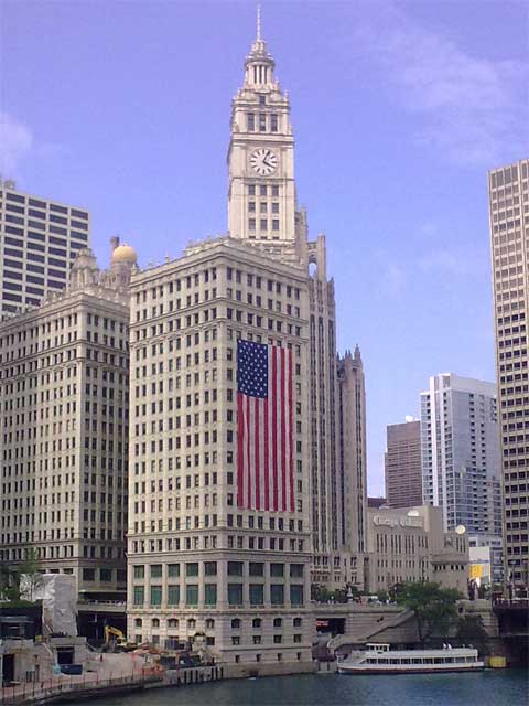 photo of US flag on the Wrigley Building, Chicago