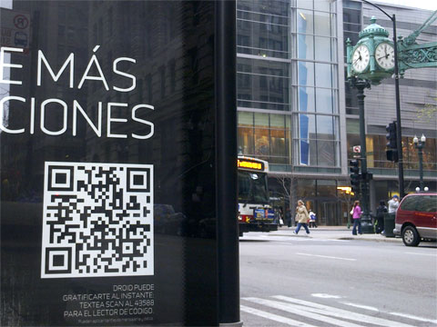 photo of bus Stop ad in Spanish with QR code and Marshall Field's, Chicago
