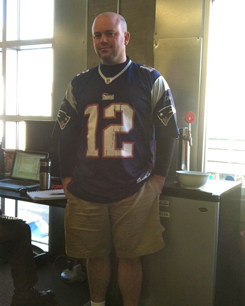 photo of Jared of Name.com wearing a Patriots Tom Brady jersey